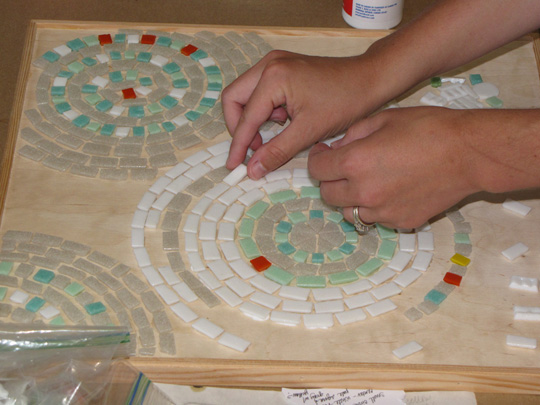 Students working in tabletop mosaic class